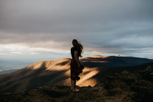 Young Woman Standing On Top Of...