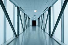 Empty Long Corridor In Modern Building, Might Be An Office, Public Building, Exhibition Grounds Or An Airport.
