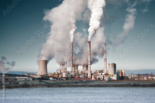Photo A coal-fired power station in the distance in agricultural landscape