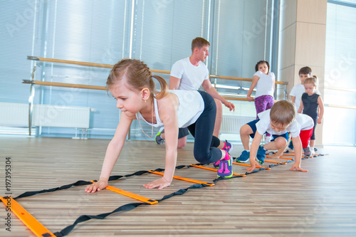 Spoed Foto op Canvas Fitness Happy sporty children in gym. Kids exercises