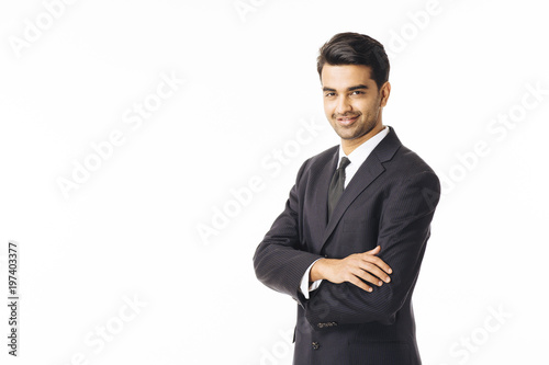 Fotografie, Obraz  Portrait of a confident young man in business suit, isolated on white background