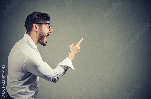 Screaming angry man with accusation Wallpaper Mural