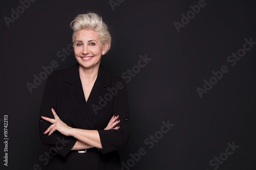 Fotografia  Elegant blonde beautiful middle aged lady posing .