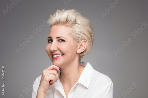 Photo  Portrait of elegant blonde middle aged woman.