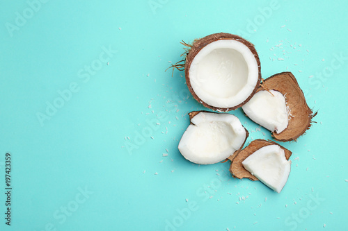Composition with fresh coconut on color background, top view
