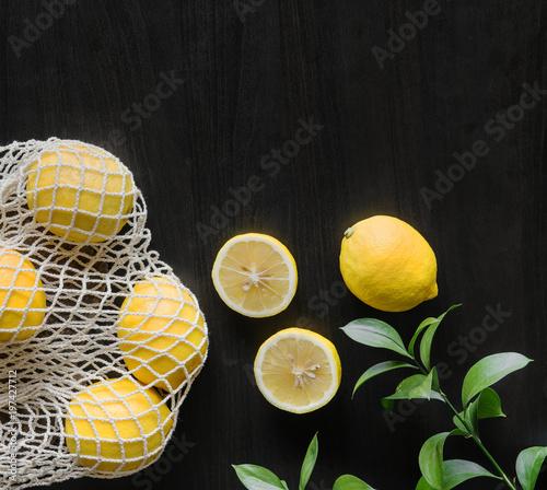 Staande foto Vlees Fresh yellow lemons on black background