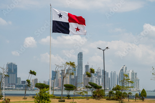 Fotomural  National flag of Panama with skyline of Panama City in background