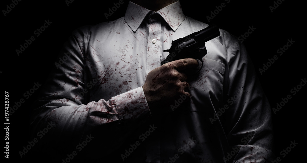Fototapeta Horror scary photo of a killer in white shirt with blood splatter and posing with black gun on dark background.