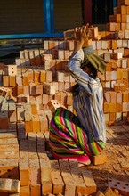A Woman Carrying Brick