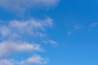 Bright blue sky with some clouds - for background, copyspace
