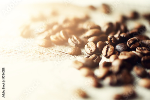 Keuken foto achterwand Cafe Coffee beans on light wooden background with copyspace for text. Coffee background, food frame, texture concept. Banner