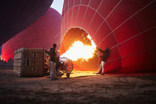 Filling With Hot Air Of Red Balloons