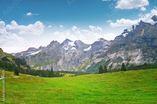 Keuken foto achterwand Alpen a beautiful mountain landscape, a forest of fir trees and ancient trees, on the tops of the mountains snow, frundenhutte Oeschinen lake, Switzerland, the Alps