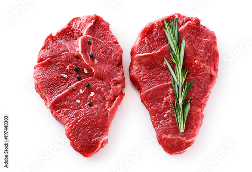 Fotografie, Obraz  Fresh raw beef steaks, pepper and rosemary isolated on white background