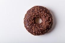 Glazed Chocolate Donut With Sweet Chocolate Sprinkles On White Background