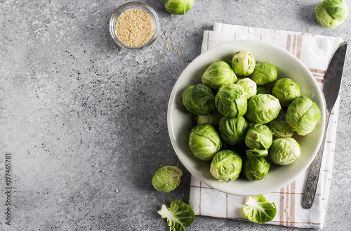 Poster Brussel Brussels sprouts cabbage fresh organic in jar on table in kitchen