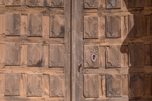 Old Wooden Door And Metal Lock Of Facade Exterior Of Church From Thirteenth Century, In Santa Maria De Riaza, Next Ayllon Town, Segovia, Castile, Spain, Europe
