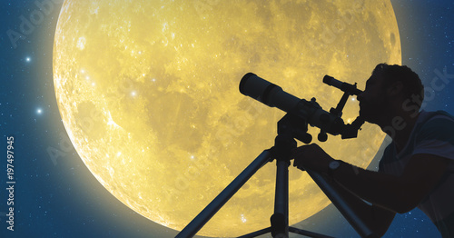Man with a telescope watching Moon and stars.