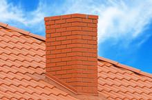 Brick Smokestack On Background Sky