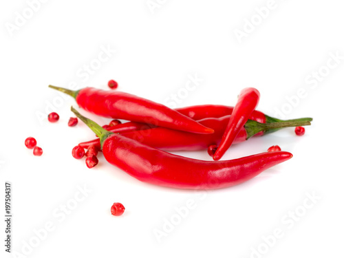 In de dag Hot chili peppers Red cayenne pepper and peppercorn on white background, side view