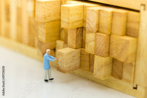 Miniature people : Worker push the wood log back into place Wallpaper Mural