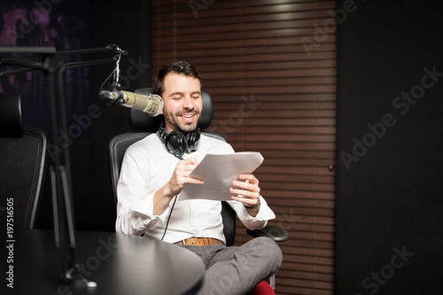 Fotografia, Obraz Male radio host broadcasting a show in studio