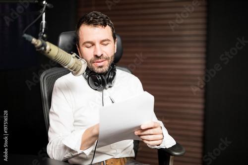 Fotografia, Obraz  Male radio presenter hosting a talk show on air
