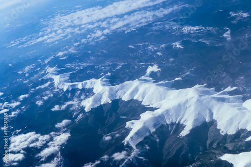Garden Poster Scandinavia Airplane view on the beautiful alpine mountains top, covered with ice.