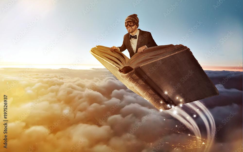 Fototapety, obrazy: Fliegendes Buch über den Wolken