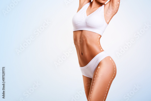 Obraz Female body cosmetic surgery and skin liposuction. - fototapety do salonu