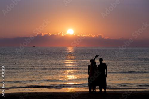Foto auf AluDibond Pier selfie on the beach sunrise