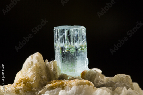 Close-up shot of an aquamarine crystal on dark background Wallpaper Mural