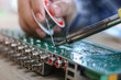 Technician desolder remove part component on board electronic for repair.