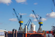 hamburg elbbruecken named river bridges container terminal docks boats and ships details and blue sky