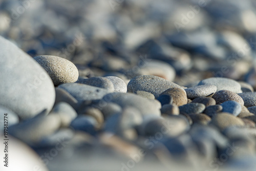 Fotografie, Obraz  Piles of grey rocks in the sand on the beach