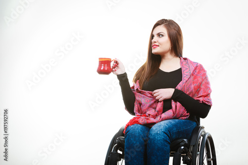 Foto  Cheerful crippled lady on wheelchair.