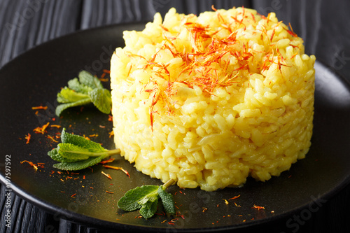 Delicious Italian risotto with saffron and mint (Risotto alla milanese) closeup. horizontal view