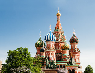 Fototapeta na wymiar Saint Basil's Cathedral and the monument to Minin and Pozharsky on the Red Square in Moscow