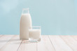 Leinwanddruck Bild - Dairy products. Bottle with milk and glass of milk on wooden table