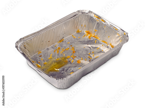 Empty dirty foil dish with rice grains and oil