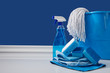 canvas print picture -  blue rags, bucket and spray for spring cleaning