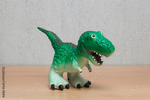 Tyrannosaurus dinosaurs toy on wooden table. Wallpaper Mural
