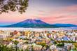 canvas print picture - Kagoshima, Japan skyline with Sakurajima Volcano at dusk.