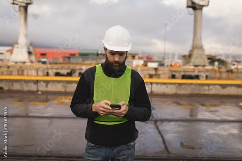 Dock worker using mobile phone