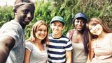 Multi ethnic teenagers smiling outdoor making selfie - 197625714