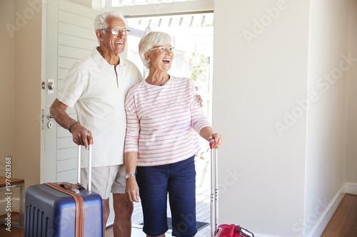 Senior Couple Arriving At Summer Vacation Rental Canvas Print
