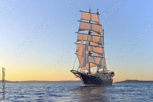Luxury yacht sailing at sunset. Yachting. Sailing © Alvov