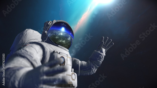Deurstickers Nasa Astronaut in outer space against the backdrop of the planet earth. Elements of this image furnished by NASA.