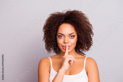 shhh! Portrait of brunette attractive stylish successful confident pretty charming lovely girl in gesture silence sign, holding forefinger on lips, looking at camera, isolated on grey background