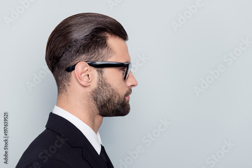 Valokuva  Half-faced profile side view close up portrait of serious focused handsome attra